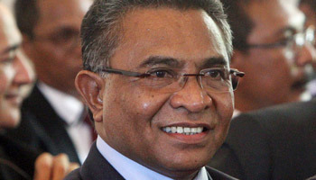 East Timor's new Prime Minister Rui Araujo smiles during his inauguration ceremony in Dili, East Timor, Monday, Feb. 16, 2015. Araujo was appointed as the country's prime minister to replace former guerrilla leader Xanana Gusmao, who resigned last week. (AP Photo/Kandhi Barnez)